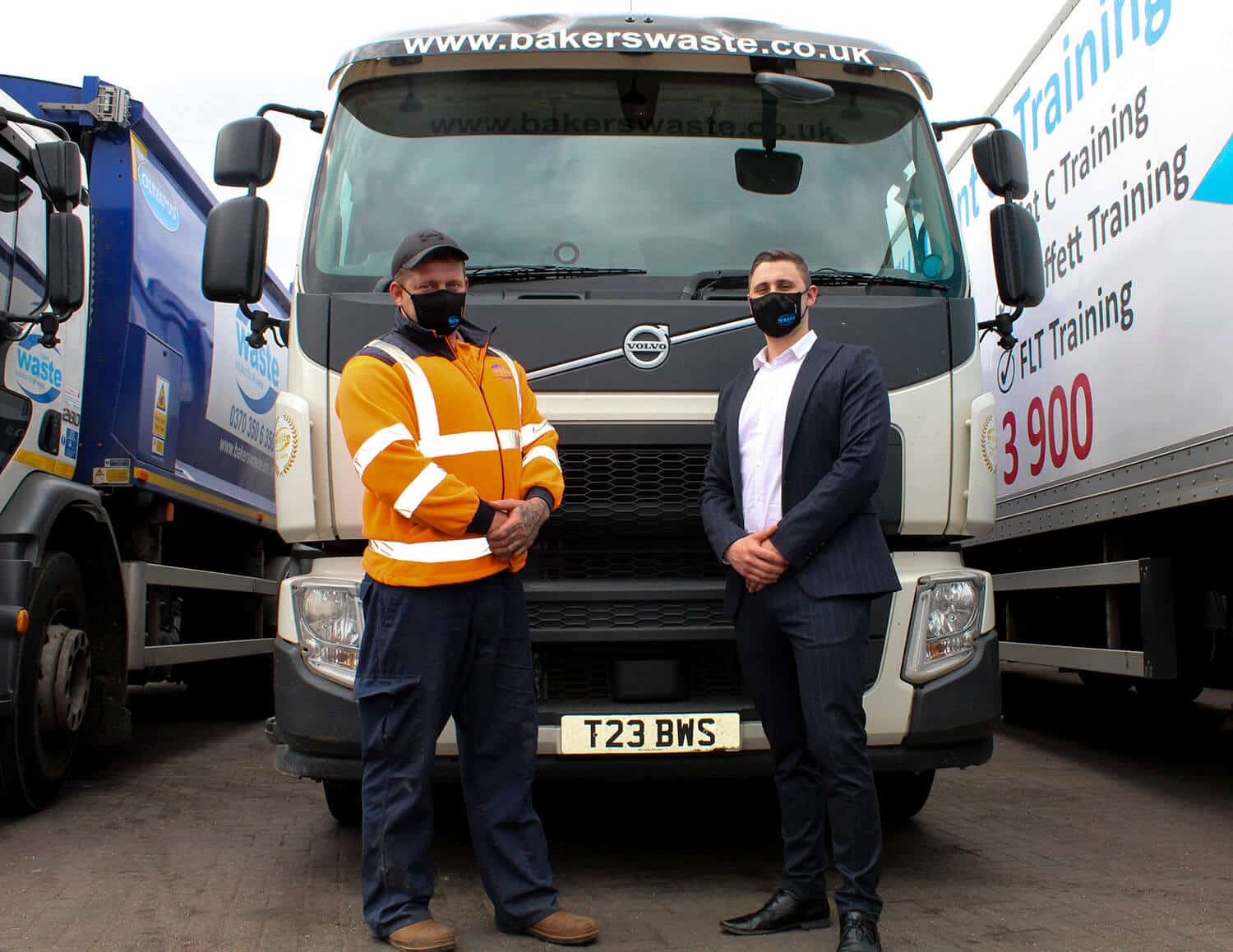 Kyle and Darrell stood in front of a trade refuse vehicle