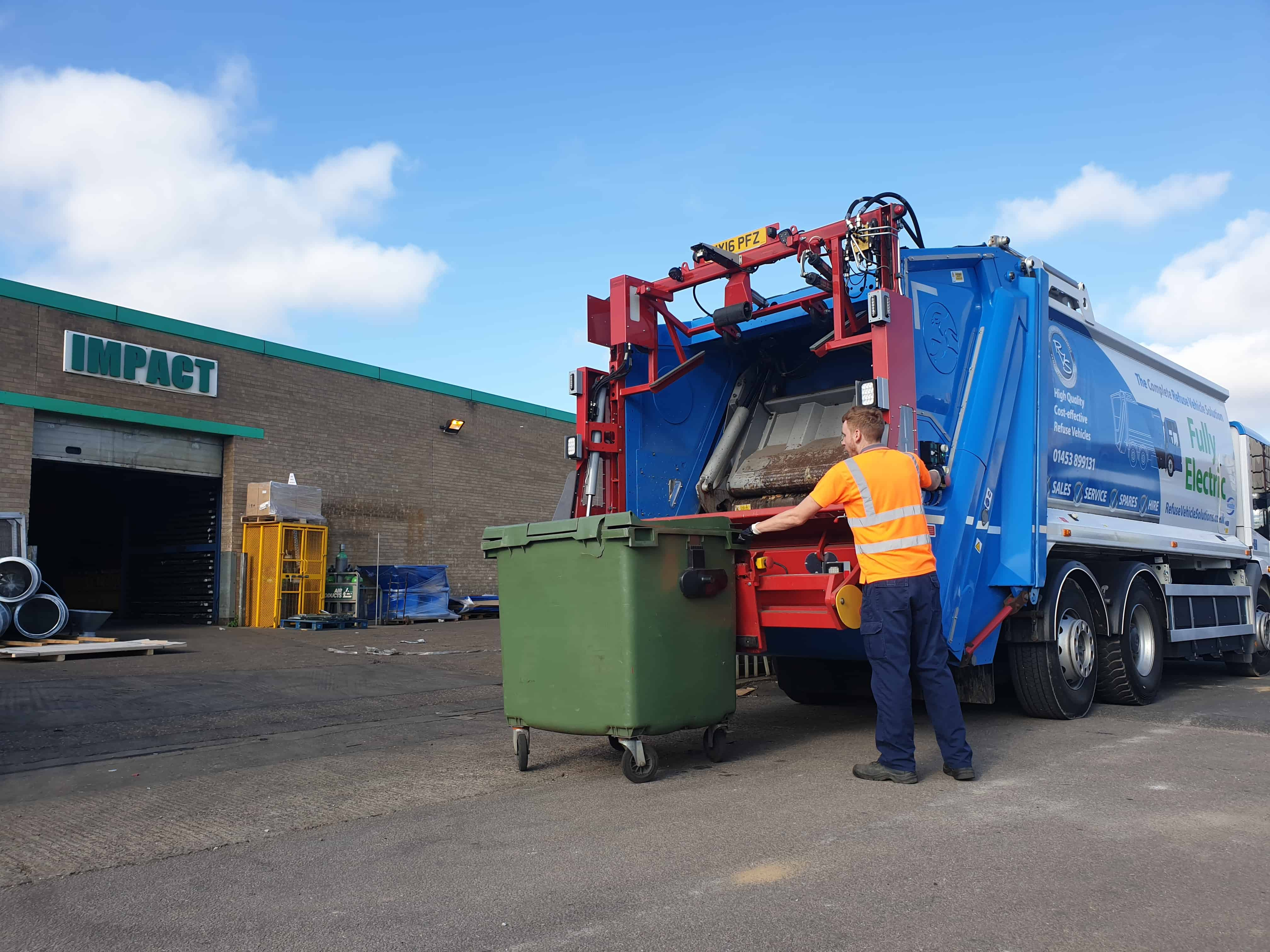 Electric refuse vehicle collecting at customers